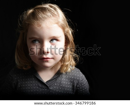 A young girl rolling her eyes on black - stock photo