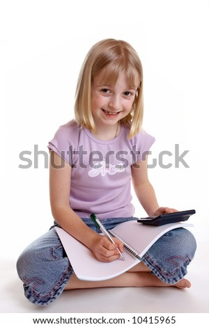 A young girl sat doing her homework