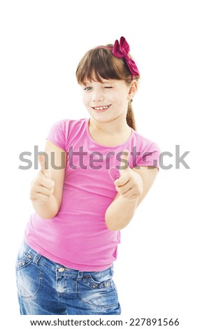 A young girl showing thumbs up with both hands over white background