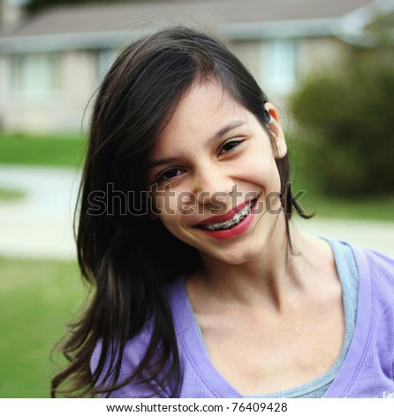 a young girl smiling - stock photo