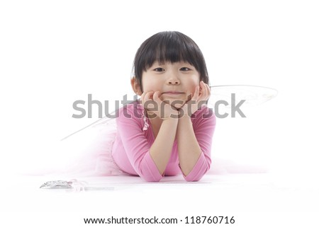 A young girl wearing a pink tutu shot in the studio against a white background. - stock photo