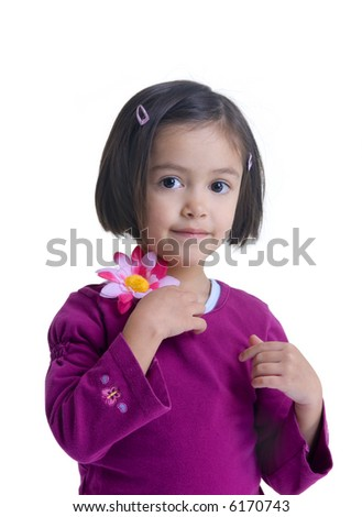 A young girl with a flower.....growing up. Childhood, learning, exploration family - stock photo