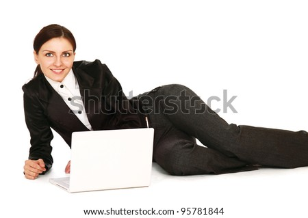 A young girl with a laptop lying on the floor, isolated on white background - stock photo
