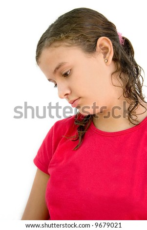 a young girl with a sad look on her face - stock photo