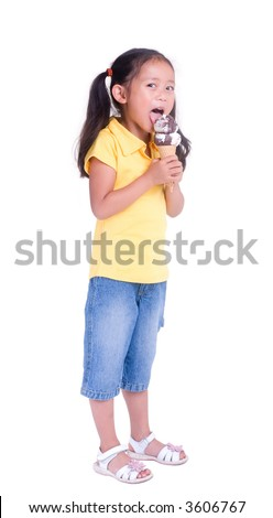 A young girl with a summertime treat. Ice cream cone. - stock photo