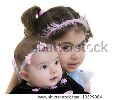 A young girl with her little sister smiling. Bonding, Love, childhood - stock photo