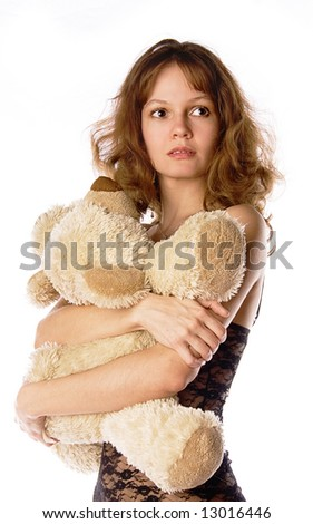 A young girl with her teddy-bear - stock photo