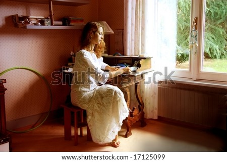 a young girl write - stock photo