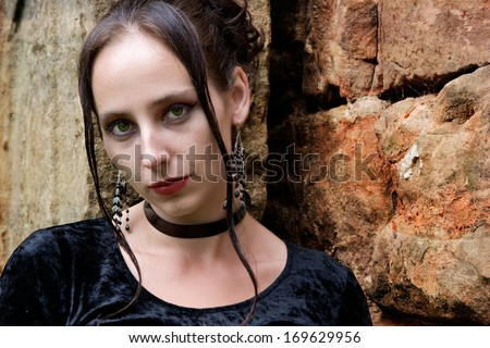 a young goth woman in monastery ruins Stadtroda - stock photo