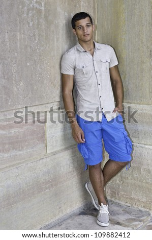 A young guy is standing in the corner of walls/Portrait of Young Guy - stock photo