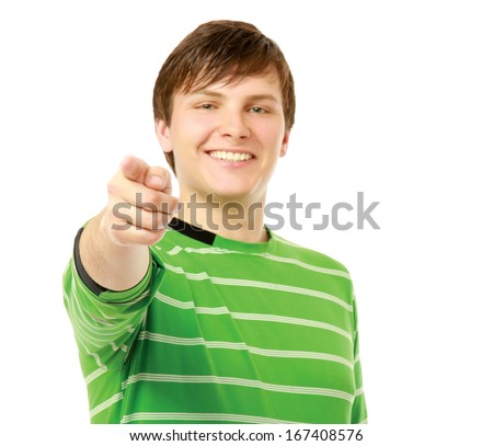 A young guy pointing at you - stock photo