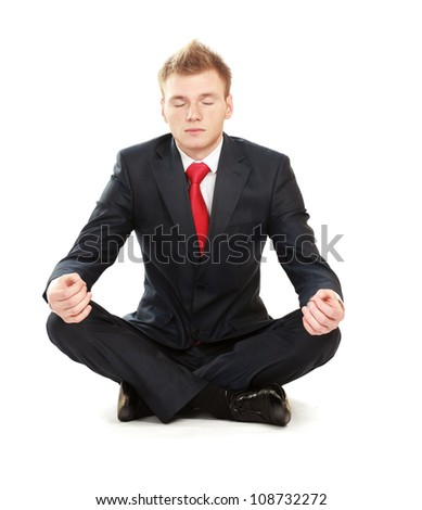 A young guy sitting on the floor - stock photo