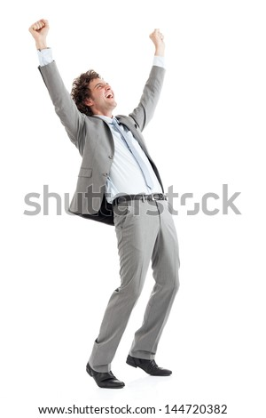 A young handsome businessman celebrating his business success. - stock photo