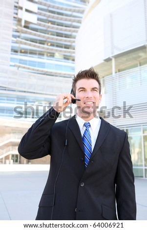A young handsome customer service man with headset outside company building
