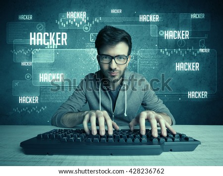 A young handsome nerd hacking internet web sites while working on computer keyboard, with digital background illustration of numbers and letters concept - stock photo