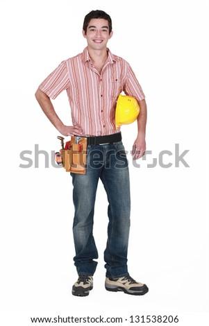 A young handyman. - stock photo