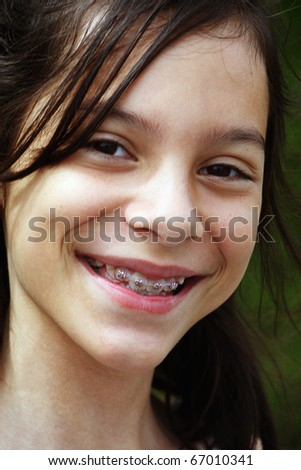 A young happy and smiling girl - stock photo