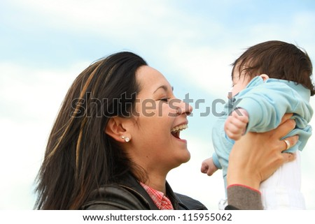 A young happy mother 22 years with her 4  month old son - stock photo