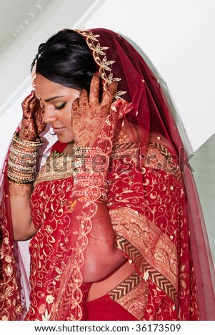 A young hindu bride waits to meet her new husband - stock photo