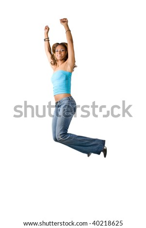 A young Hispanic woman jumping and having fun.  Isolated over  a white background. - stock photo