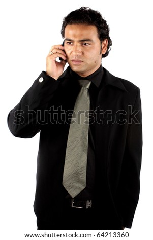 A young Indian businessman talking on the phone. - stock photo