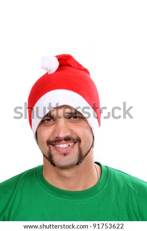 A young Indian guy wearing a santa hat during Christmas in India, on white studio background.