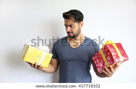 A young indian man holding gift box Isolated on white background. - stock photo