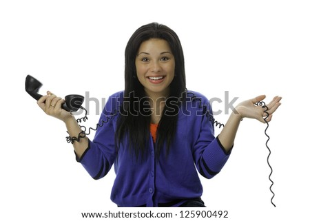 A young lady talking on the telephone - stock photo