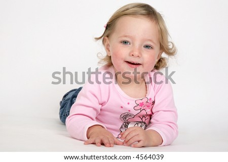 A young little girl smiling - stock photo