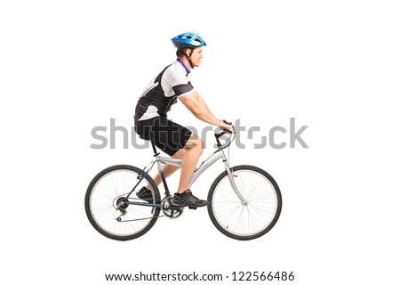A young male bicyclist riding a bicycle isolated against white background - stock photo