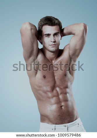 a young male model posing his muscles.