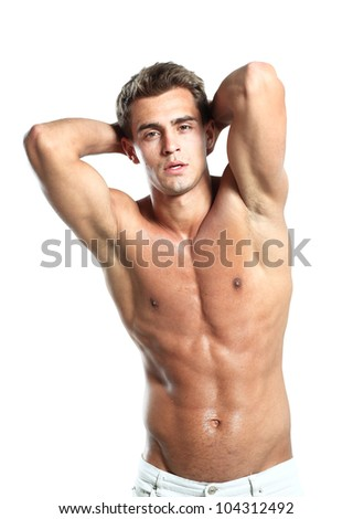 a young male model posing his muscles - stock photo