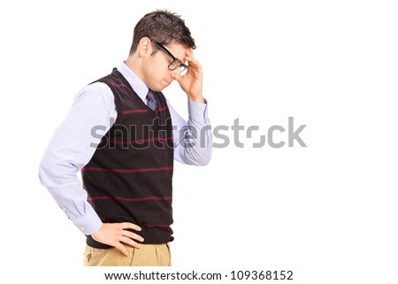 A young male with head down thinking isolated on white background - stock photo