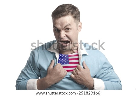 A young man - a patriot: shows the flag of USA on his chest