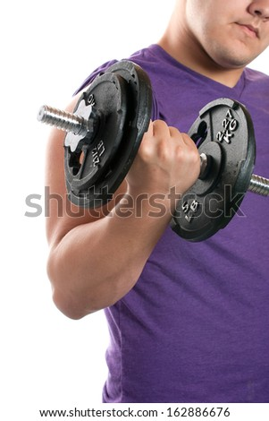 A young man curling a dumbbell over a white background.
