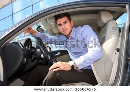 a young man driving the new car