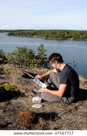A young man finding a geocache