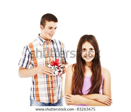 A young man has a surprise for his girlfriend. All on white background. - stock photo