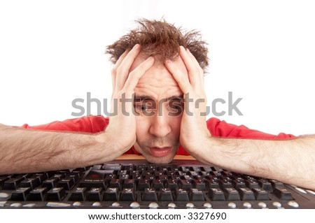 a young man having problems with computer - stock photo