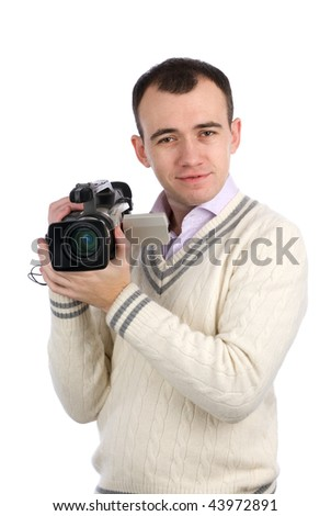 A young man holding a camcorder isolated on a white background - stock photo