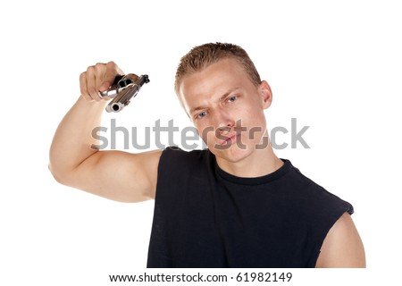 a young man holding a gun aimed at the camera with a serious expression on his face.