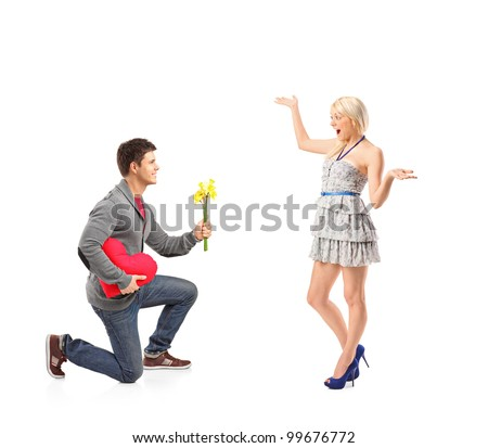 A young man holding bunch of flowers and his excited girlfriend isolated on white background - stock photo