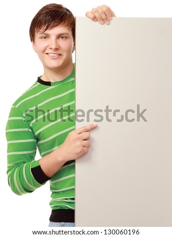 A young man holding empty blank, isolated on white background - stock photo