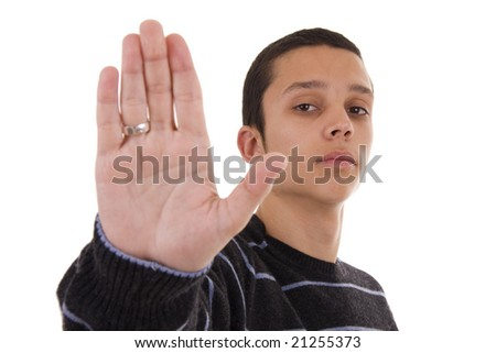 A young man holding up his hand in a stop sign