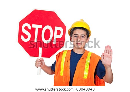 A young man holds up a stop sign together with a hand signal to stop. - stock photo