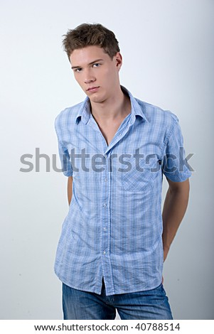 A young man in a blue denim and blue shirt