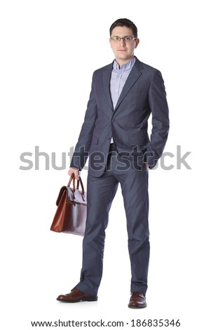 a young man in a gray suit with a briefcase hands isolated on white background  - stock photo