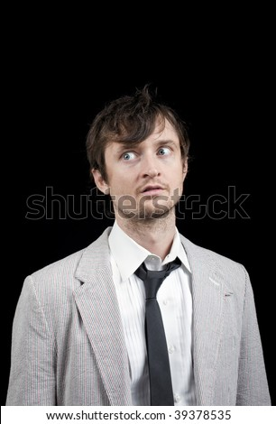 A young man in mismatched and disheveled clothing - stock photo