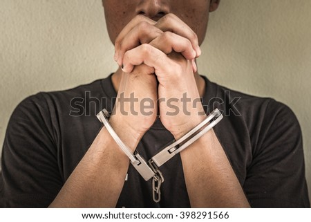 a young man in shackle. background look old or vintage style. (vintage color tone) - stock photo