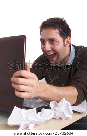 A young man is excited about what he sees on his laptop. Isolated over white. - stock photo